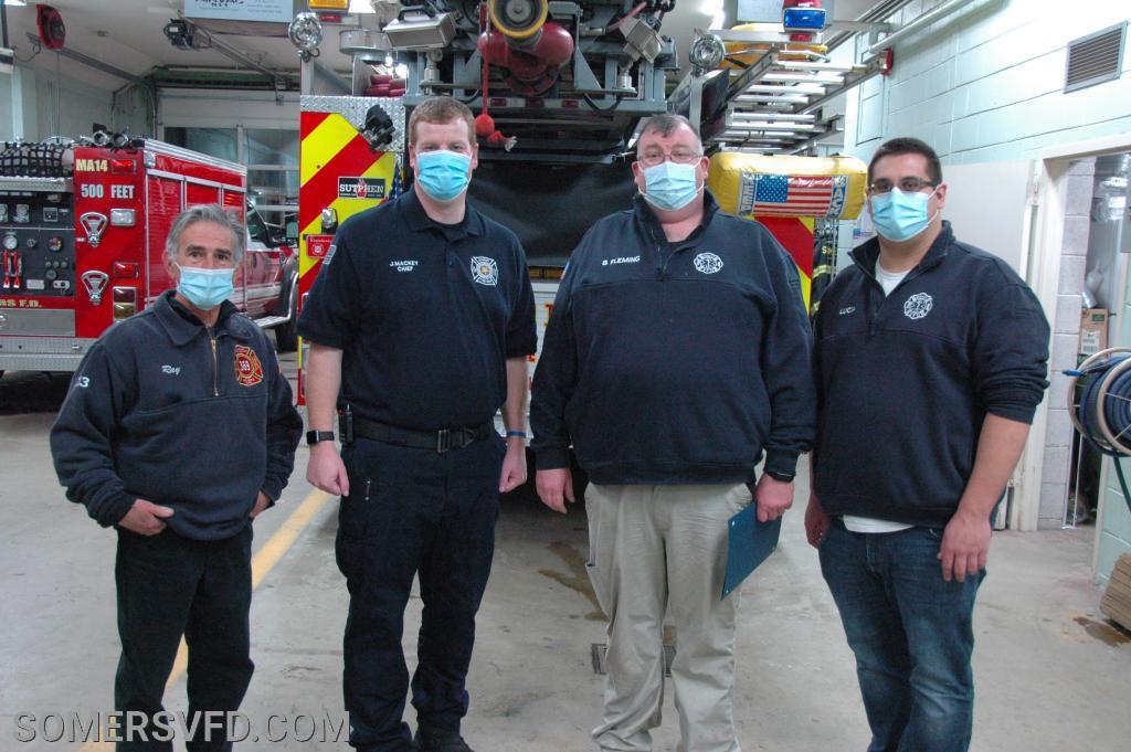 Firefighter/EMT Brian Fleming receiving his award