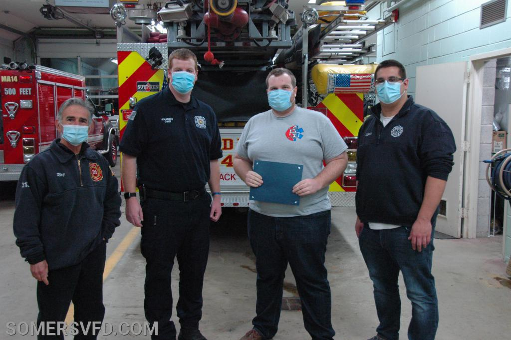 Firefighter/EMT Doug Crockatt receiving his award