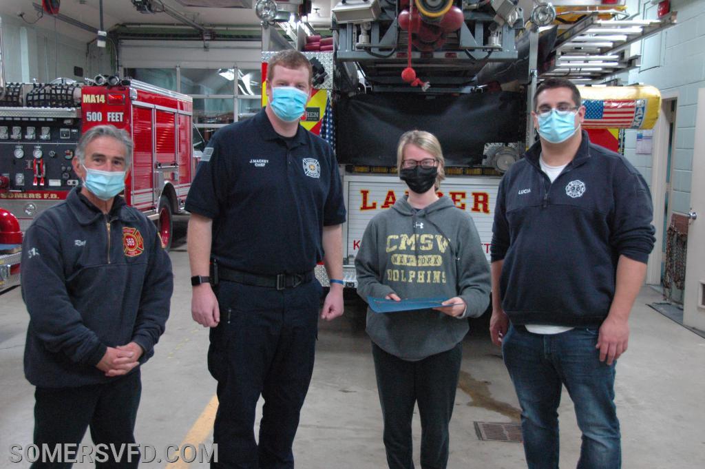Firefighter Bridget Foley receiving her award