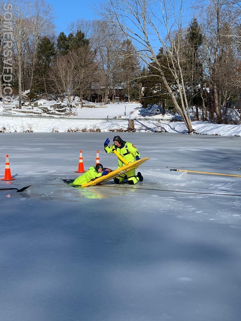 Chief Jon Mackey rescuing EMT St. John